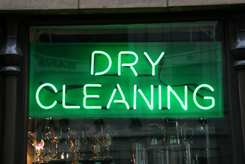 Shop window view in London - Dry Cleaning neon