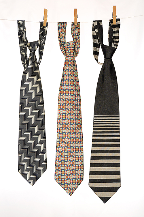 Three Ties Hanging on a Rope with Wooden Pegs.